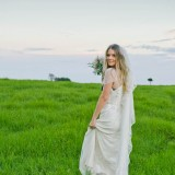 Spicers Clovelly Estate Wedding couture Bride in the field